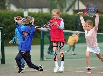 Kids enjoying tennis