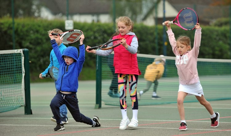 Kids enjoying tennis