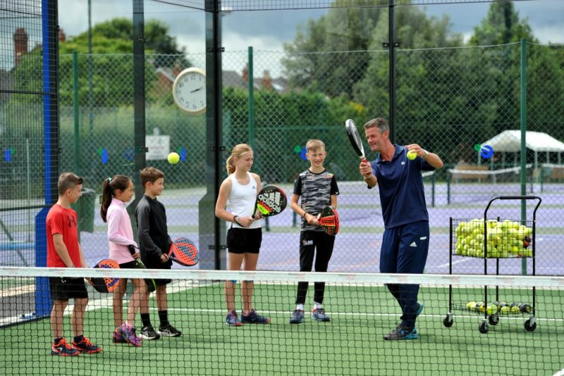 Kids being coached at padel